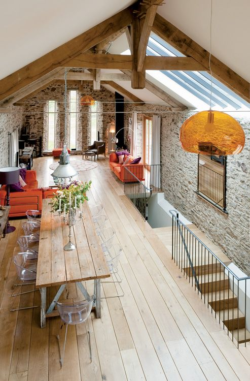 18th century Devon long barn conversion with mezzanine floor furnished with an eclectic mix
